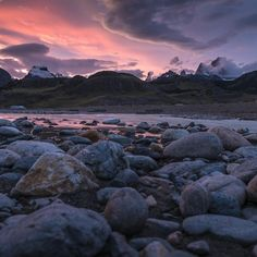 Photo by @michaelclarkphoto // A colorful evening with good light over Cerro Torre (middle) and Fitz Roy (right) with the Rio Fritz Roy in the foreground. This was shot just south of the town of El Chalten, Argentina one evening after traversing the Patagonia Ice Cap last year. #patagonia #cerrotorre #cerrofitzroy #argentina #elchalten #elchaltén