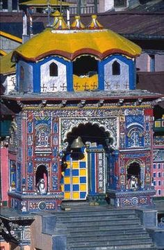 Badrinath Temple, India Architecture:   resembles a Buddhist vihara (temple), with the brightly painted facade typical of Buddhism temple..Approx 50 ft tall with a small cupola covered with a gold gilt roof. The facade is built of stone, with arched windows. a tall arched gateway is the main entrance leads to a large pillared hall  The walls and pillars of the mandapa are covered with intricate carvings