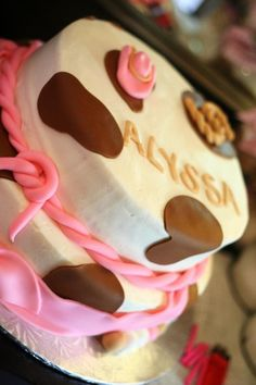 Cowgirl/cowboy party ideas - cow print cake