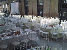"White Chiavari Chair with White Leatherette Seat, Gallery Tables 42"" Wide, Regency Silver Flatware, Glass Oceana China, Standard Glassware, Green Leaf Organza, White Crinkle Linen, White Frette Linen 