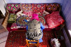High angle view of Mari woman sitting near embroidered couch by Gable Denims on 500px
