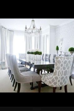 Gorgeous Dining Room! Luxury, calm, bright. Obsessed with quilted studded dining chairs ATM!