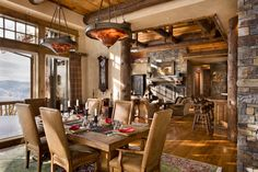 Dining Room - LOVE the use of the logs between rooms and trim on the ceiling....