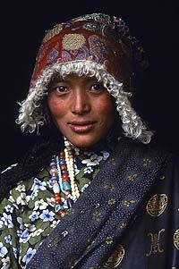 Tibetan Woman at a temple in Amdo. 2001, Kham, Tibet. Face of Asia: Steve McCurry Photographs at Asia House. © 2005 Steve McCurry