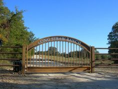 View some of our custom ranch gates at Aberdeen Custom Gate and Iron. Front Gates, Entrance Gates, Farm Entrance, Entrance Ideas, Iron Gate Design, Security Gates, Custom Gates, Steel Gate, Metal Gates