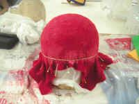 Really cool instructions for making a felt hat using a styrofoam form, pins, water, and white glue. The method really works!