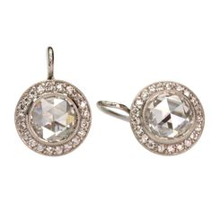 """2.45cttw H/SI1/SI2 Rose cut diamonds set in platinum hand crafted """"Single Stone"""" mountings."""