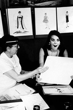 Natalie Wood with Edith Head going over the sketches for 'Sex and the Single Girl'.