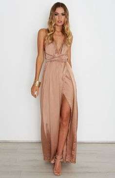 """<p><strong style=""""font-family: arial, helvetica, sans-serif;"""">Description</strong><br /><span style=""""font-family: arial, helvetica, sans-serif; font-size: small;"""">- Satin Look Maxi Dress</span><br /><span style=""""font-family: arial, helvetica, sans-serif; font-size: small;"""">- Halter Neck Straps that Wrap Around Waist</span><br /><span style=""""font-f..."""