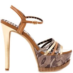 Get sky high height from this towering Jessica Simpson stiletto.  The Skye features a multi color metallic and snake printed upper with adjustable closure and multiple strap vamp.  A 5 3/4 inch stiletto heel and python printed 2 inch platform completes this confident sandal.