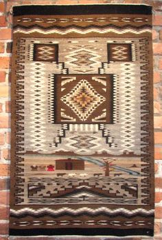 All hand spun wool which is natural colors and vegetal dyed yarns. Alice Begay has always woven finely detailed Navajo weavings and this one is a combination of styles of Two Grey Hills, a Storm Pattern and a Pictorial to make up the style of Burnham.