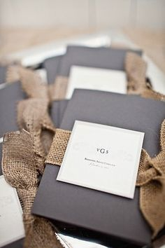 Rustic, burlap fabric added simple decorative accents to the ceremony programs.