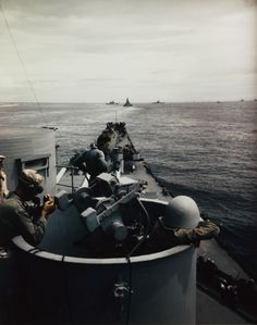 USS IOWA (BB-61) - View from the forward superstructure, as the ship follows other battleships out of a Pacific Anchorage during 1944 [2519 x 3200]