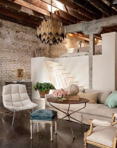 I continue to have a soft spot for lofts and this one with classic and feminine touches mixed with vintage industrial pieces make this so perfectly eclectic. And how freaking brilliant - a bank of Ike
