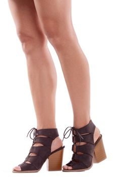 As if you weren't already the life of the party, the Show Stopper Charcoal Grey Lace Up Sandals will make it impossible to look away! Velvety vegan suede forms a peep-toe upper, with cut out sides lacing together at the top of the foot. The open back is supported by a block heel. #heels #shoes #laceup