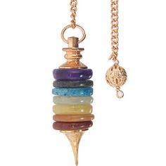 Metal Pendulum with 7 Chakra Rings Copper - Each stone ring, representing one of the chakra colors, is housed between a copper point and base on this gorgeous pendulum. The pendulum's chain has a small ornate copper sphere attached to the end for slip free handling.