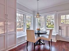breakfast nook after reno - desperately needs new light fixture and maybe some bamboo shades but love the white woodwork