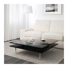 TOFTERYD Coffee table IKEA Separate shelf for magazines, etc. helps you keep your things organised and the table top clear. Ikea Living Room Tables, Home Living Room, Living Room Decor, Modern Black Coffee Table, Coffee Table High Gloss, Black Glass Coffee Table, Ikea Coffee Table, Cool Coffee Tables, Range Magazine