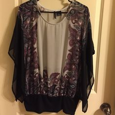 NWOT sheer oversized gray/maroon paisley print top NWOT sheer oversized top wig gray down middle & each sizes a some-what maroon paisley print w/a touch of green & black. Wing black sheer sleeves & knit bottom. Size Medium, but will probably fit M/L new directions Tops