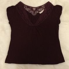 Burgundy Crop Top Super cute crop top with cap sleeves. Has lace crochet around the neckline. Very lightly used.  The tag says medium, but it fits rather small. Forever 21 Tops Crop Tops