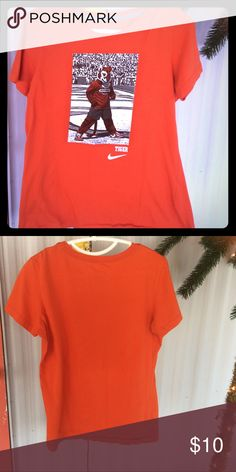 Nike Clemson Tigers ladies  XL. Buy one get 1 free Gently worn with tons of wear left in it.  This is a ladies for tshirt and is slim fit. Made of 100% cotton. Nike Tops Tees - Short Sleeve