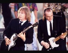 Rick Parfitt and Francis Rossi of Status Quo perform on stage, Croydon, United Kingdom, 1996