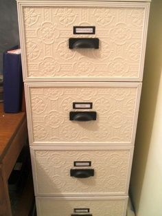 File cabinet spruced up with wallpaper. Cool