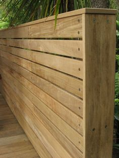 Fence or screen with horizontal vitex battens. Fixed with Stainless steel screws. High quality finish, which can either be left to weather or be oiled/stained.