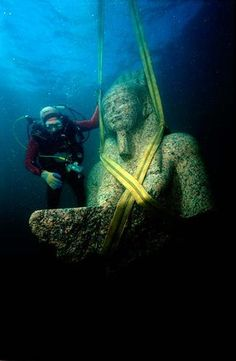 A colossal statue of red granite (5.4 m) representing the god Hapi, which decorated the temple of Heracleion. The god of the flooding of the Nile, symbol of abundance and fertility, has never before been discovered at such a large scale, which points to his importance for the Canopic region.