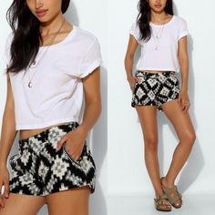 """UO Love Sam Ikat Shorts Lightweight and soft woven shorts by Love Sam.  All over geo Ikat pattern with embroidered detail along the side pockets.  Sits at the hip with button and fly closure.  Worn once and in excellent condition with no visible signs of wear.  Purchased from Urban Outfitters.  31"""" waist/hip, 10"""" long waist to bottom with 2"""" inseam. Urban Outfitters Shorts"""