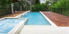 This awesome beautiful bush setting and timber decked area along with the concrete tiled edging and a semi-infinity end to the pool provides a great backdrop for this private home pool and spa area Swimming Pool Images, Swimming Pool Designs, Swimming Pools Backyard, Lap Pools, Pool Spa, 8 Pool, Jacuzzi, Inside Pool, Geometric Pool