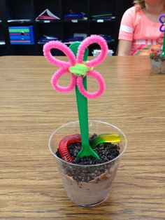 School birthday treats - dirt cup (chocolate pudding, Cool Whip, crushed Oreos), gummy worms, and a flower spoon.