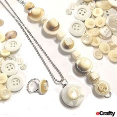 DIY button jewelry recipe: Start with our vintage button mix in white/pearls, e6000 onto our glue-on ring, bracelet and pendant forms, and voila ~ you've just made a whimsical, breezy button jewelry trio! Enjoy
