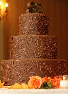 Chocolate cake with monogram swirls and ribbon topper; potential groom's cake? brown weddings, chocolates, tooled leather, swirl, autumn weddings, chocolate wedding cakes, groom cake, chocolate cakes, unique weddings