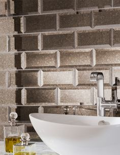 This elegantly bevelled glass tile has an antiqued mirror effect inspired by Madrid's domed glass mansion, Palacio de Cristal. Add a touch of opulence to your kitchen splashback or make a bathroom feature with either the rustic bronze or sparkling silver depending on your style.