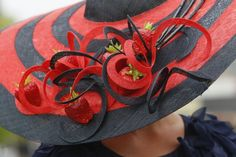 A race goers wearing ornate hat arrives for the third day, traditionally known as Ladies Day, of the Royal Ascot horse race meeting at Ascot, England, Thursday, June, 16, 2011.