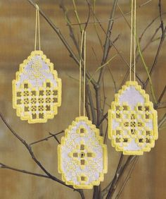 Three pretty yellow and white egg decorations in hardanger.