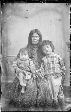 Gazie (aka Twisted) the wife of Chihuahua, and her children - Chiricahua Apache - 1886