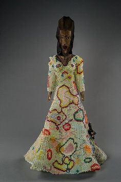 """Pretty Veiled Girl"", bead sculpture by Joyce Scott, 2012. Nigerian wooden object, plastic and glass beads, thread drawing, fabric"