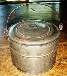 Antique lunch pail~my great grandma had one like this only it was blue & I have it now~<3 it~