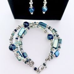 One-of-a-kind Blue Apatite and Mother of Pearl shell bead bracelet and earring set. Handmade in Marysville Victoria by Kerami Studio. ~*~ #apatite #blueapatite #motherofpearl #gemstonejewellery #uniquejewellery #tibetansilver #ooak #handmadejewellery #handcraftedjewellery #handmadeearrings #statementjewellery #handmadebracelet #jewelleryaddiction #blueapatitebracelet #earringlove #statementearring #earringstyle #earringfashion #earringdesign Handmade Jewellery, Handmade Bracelets, Handcrafted Jewelry, Earrings Handmade, Beaded Bracelets, Unique Jewelry, Marysville Victoria, Stone Beads, Glass Beads