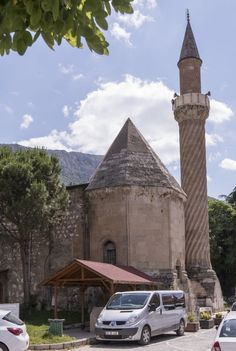 Exterior view from northeast. Back of Cumudar tomb and minaret are visible. Burmalı Minare Camii Amasya, Turkey
