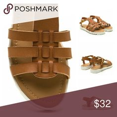 "Coastal Cutie Faux Leather Sandals Look cute and walk comfortably in these spunky shoes. Open-toe sandals feature a lightly distressed vegan leather upper with triple straps that are woven through a wide center panel. Finished with an adjustable buckled ankle strap, a lightly padded footbed, and a rubberized lug sole platform.  Platform height: 0.75"" Man made materials Shoes Sandals"