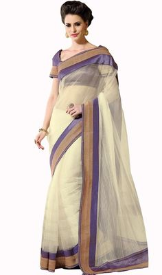 You will look drop-dead gorgeous by stepping into this butter cream shade net embroidered saree. You can see some intriguing patterns carried out with lace and stones work. Upon request we can make round front/back neck and short 6 inches sleeves regular sari blouse also. #FancyDesignOfWhiteNetSari