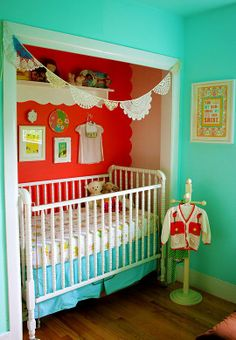 brilliant! who knew the crib could fit in the closet and then paint it with a super great accent color!! Aqua and red vintage nursery.