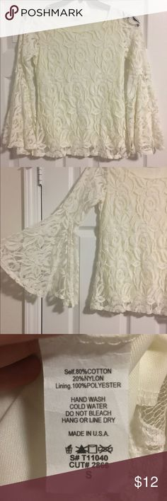 NWOT bell sleeve top Cream colored bell sleeve lace top. Never worn. Bought from a boutique and never had an occasion to wear it. Size small. Tops Blouses