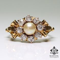 Period: Victorian (1836-1901) Composition: 18 K Gold Stones: - 8 Old mine cut diamonds of H-VS2 quality that weigh 1ctw. - 1 Culture pearl of 5.50mm Ring size: 8 1/2 Ring face: 12mm by 19mm. Rise abov