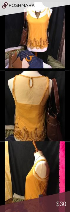 """Women's cute Gold top Small nwt Jennifer Lopez Nice detail on this top! Dress up or down feminine and sexy. Brand new with tags Jennifer Lopez. Measures 17 """" pit to pit and all the way down on the outside netting. There is some stretch to the netting as well as the cami underneath. Length is 23"""". Bundle and save! Pls only reasonable offers and no trades. Jennifer Lopez Tops Camisoles"""