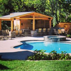 Outdoor pool, patio, outdoor structure and custom kitchen designed and installed by Kinwood, Franklin, TN.