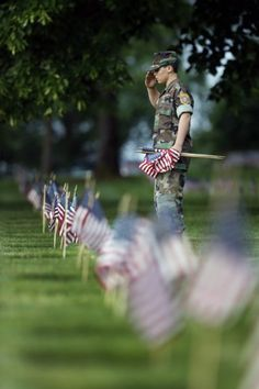 Mark Morales, 12, of Portland, a member of the Young Marines, salutes.